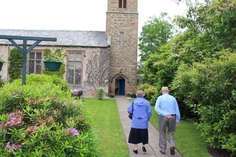 A couple on the path to the church door