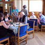 A group of people enjoying a coffee in the Kinloss hall